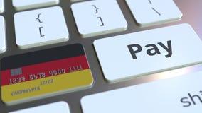 Карта банка отличая флагом Германии как ключ на клавиатуре компьютера Анимация немецкого онлайн-платежа схематическая иллюстрация штока