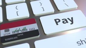 Карта банка отличая флагом Ирака как ключ на клавиатуре компьютера Анимация иракского онлайн-платежа схематическая бесплатная иллюстрация