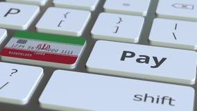 Карта банка отличая флагом Ирана как ключ на клавиатуре компьютера Анимация иранского онлайн-платежа схематическая иллюстрация штока