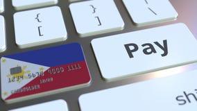 Карта банка отличая флагом Филиппин как ключ на клавиатуре компьютера Анимация онлайн-платежа схематическая иллюстрация вектора