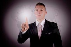 Карта бизнесмена и мира. Стоковые Фото