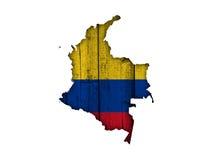 Карта и флаг Колумбии на выдержанной древесине Стоковая Фотография
