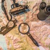Карта Патагонии, компаса, камеры, monocular и loupe Стоковое Фото