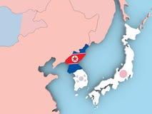 Карта Северной Кореи с флагом на глобусе иллюстрация штока