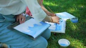 Картина акварели с учителем в парке города видеоматериал