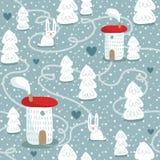 Картина зимы безшовная с домами, деревьями и кроликами Стоковое Фото