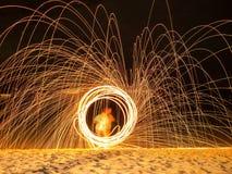 Картина источника света огня в береге моря Стоковые Изображения RF