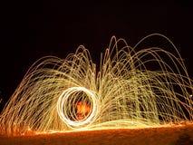 Картина источника света огня в береге моря Стоковая Фотография