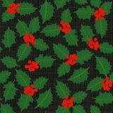 Картина листьев и ягод падуба безшовная на темноте Стоковое фото RF