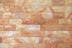Картина и цвет предпосылки текстуры кирпичной стены песчаника Стоковая Фотография RF