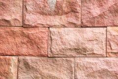 Картина и цвет предпосылки текстуры кирпичной стены песчаника Стоковое Изображение RF