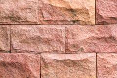 Картина и цвет предпосылки текстуры кирпичной стены песчаника Стоковые Фотографии RF
