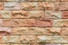 Картина и цвет предпосылки текстуры кирпичной стены песчаника Стоковое Изображение