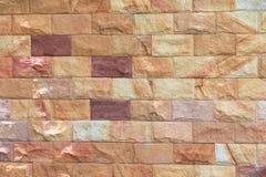 Картина и цвет предпосылки текстуры кирпичной стены песчаника Стоковые Фото
