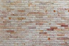 Картина и цвет предпосылки текстуры кирпичной стены песчаника Стоковые Изображения RF