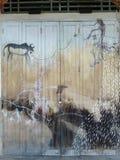 Картина каменного века на старой деревянной двери Стоковые Фото