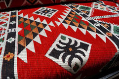Картина ковра в красных цветах Стоковые Изображения