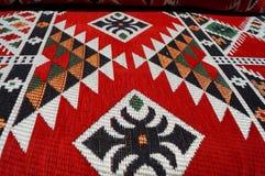 Картина ковра в красных цветах Стоковое Изображение