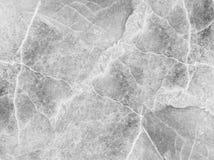 Картина крупного плана поверхностная мраморная на мраморной предпосылке текстуры каменной стены в черно-белом тоне