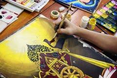 Картина мальчика с paintbrush и красочными красками Стоковые Фото