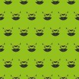 Картина милого кота головная безшовная на зеленой предпосылке Стоковая Фотография RF