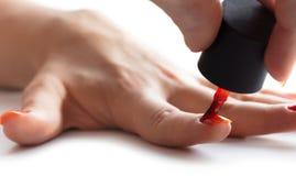 Картина ногтя с красным лаком Стоковое Изображение