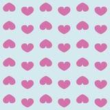 Картина от розовых сердец изолированных на голубой предпосылке Стоковые Изображения