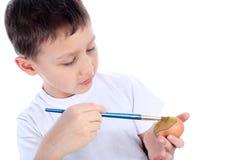 картина пасхального яйца мальчика Стоковые Изображения