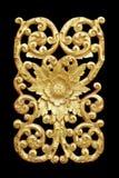 Картина древесины высекает краску золота для украшения на черноте Стоковое Фото