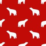 картина рождества безшовная Полярный медведь на красной предпосылке Стоковое фото RF