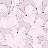 Картина розовых лошадей girlish безшовная с предпосылкой звезд Стоковая Фотография