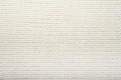 Картина связанной белизной текстуры ткани Шерстяная предпосылка Стоковое Изображение RF
