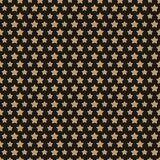 Картина стиля золота звезды рождества безшовная на черной предпосылке Стоковое фото RF