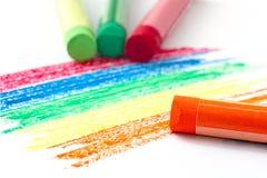 Картина цвета радуги и пастель оранжевого масла на белой предпосылке Стоковое фото RF