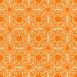 Картина этнических кругов оранжевая безшовная Стоковые Фотографии RF