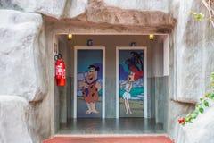 Картина Bathhroon Flintstone Фреда и Вильмы Стоковые Фото
