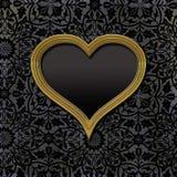 Картинная рамка золота пустая в форме сердца Стоковые Изображения