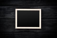 Картинная рамка на серой стене Стоковое фото RF