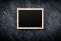 Картинная рамка на серой стене Стоковые Изображения RF