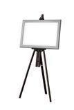 Картинная рамка при деревянный изолированный мольберт стоковые изображения rf