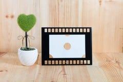 Картинные рамки на деревянном поле Стоковая Фотография
