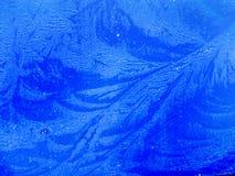 картины льда на синем стекле стоковое изображение
