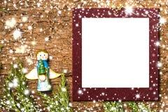 Карточка ангела рождества kpugloe отверстия рамки предпосылки красивейшее черное сделало по образцу фото Стоковая Фотография RF