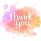 карточка благодарит вас Рукописная белая фраза на пинке Стоковое Фото