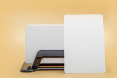 Карточка посещения шаблона дела модель-макета в владельце карточки на оранжевой предпосылке Стоковое Изображение