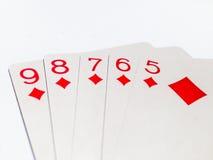 Карточка прямого потока в игре в покер с белой предпосылкой Стоковая Фотография RF