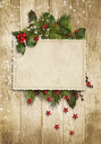Карточка рождества винтажная с падубом, елью Стоковые Фотографии RF