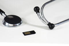 Карточка стетоскопа и sim Стоковое фото RF