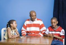 Карточки семьи играя стоковое изображение rf