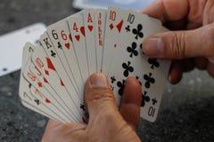 карточки топят играть покер королевский стоковые фото